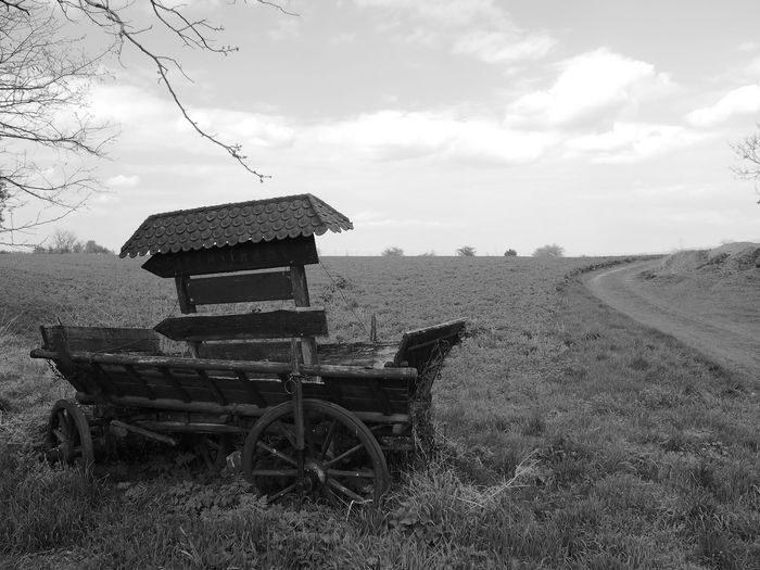 Agriculture Agriculture Beauty In Nature Black And White Cart Cart Road Cloud - Sky Clouds Day Farm Field Growth Landscape Monochrome Nature No People Outdoors Road Sky Wooden Cart