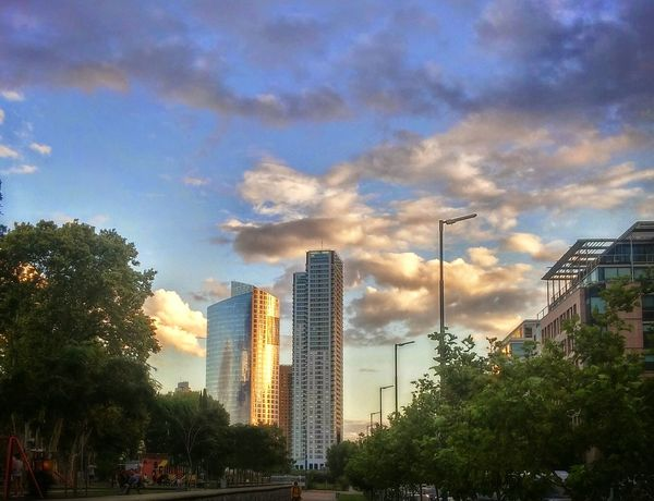 City Outdoors Skyscraper Cloud - Sky Architecture Urban Skyline Day Sky Cityscape  Sunset City Lights Modern City Life Multi Colored Illuminated Building Exterior Sunset Colors Sunset And Clouds  Sunset Clouds And Sky City Street Sunlight Clouds The Architect - 2017 EyeEm Awards