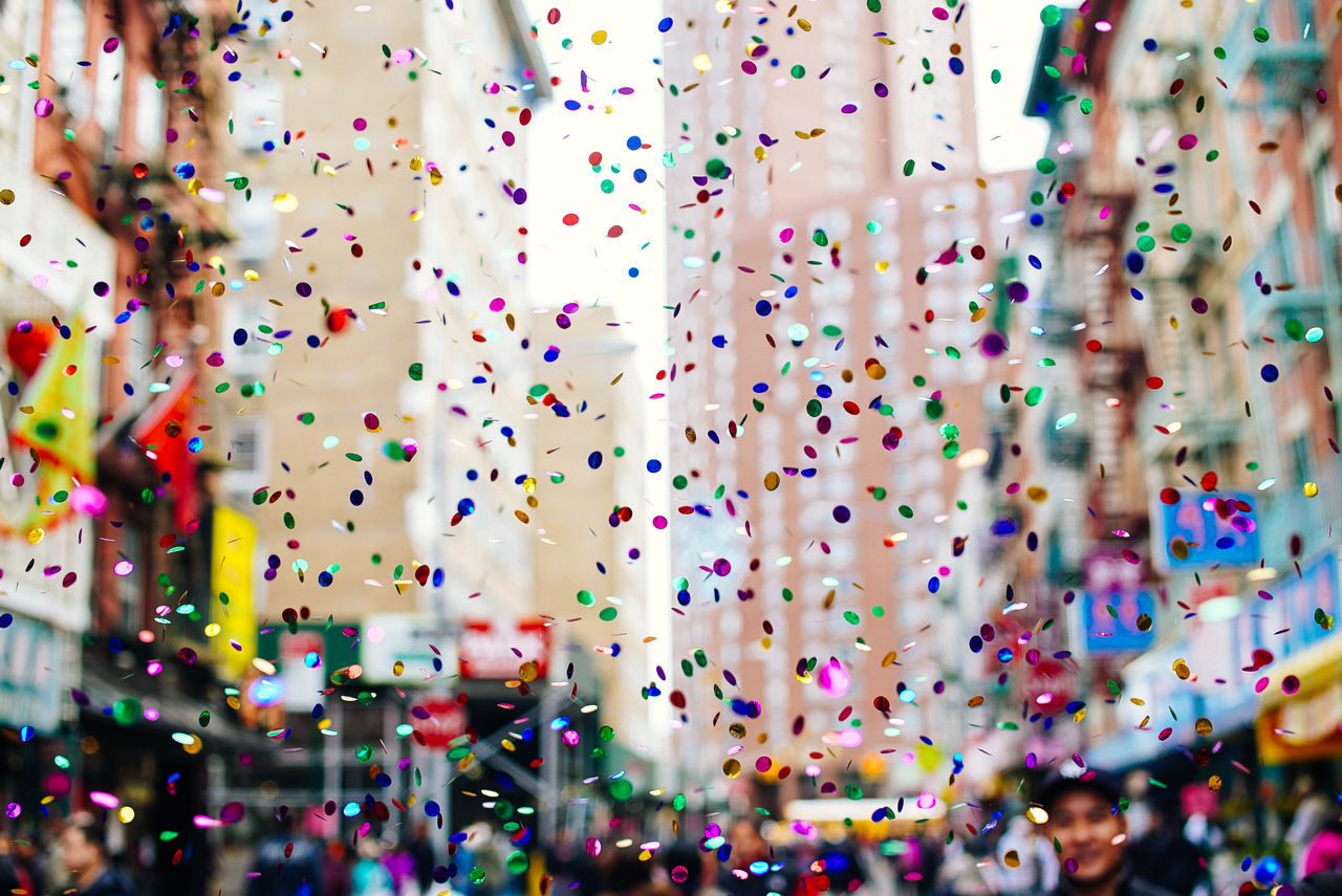 Close-up of multi colored confetti in city