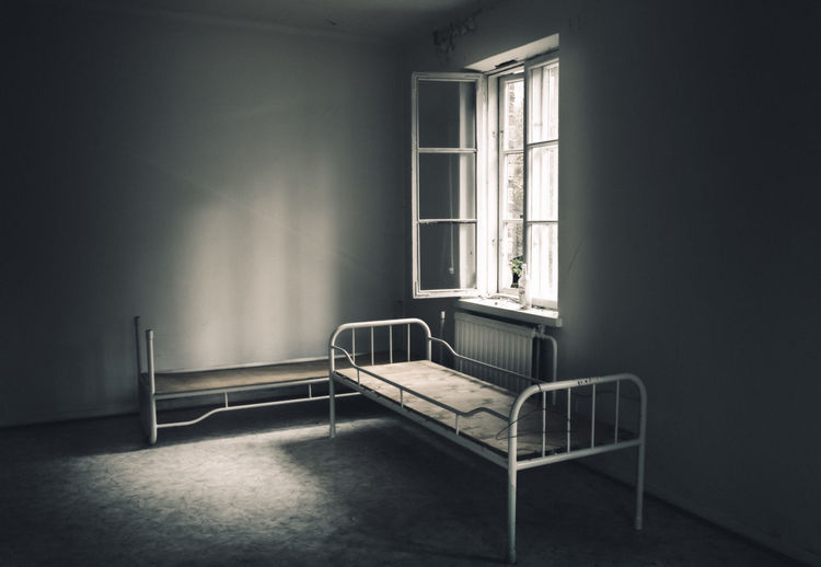 Very gloomy abandoned and broken house Abandoned Places Alcohol Apartment Ascetic Bed Beds Bottle Broken Glass Dark Darkness And Light Day Decay Fragments Gloomy House Indoors  No People Open Sharp Window Window Ledge Worn