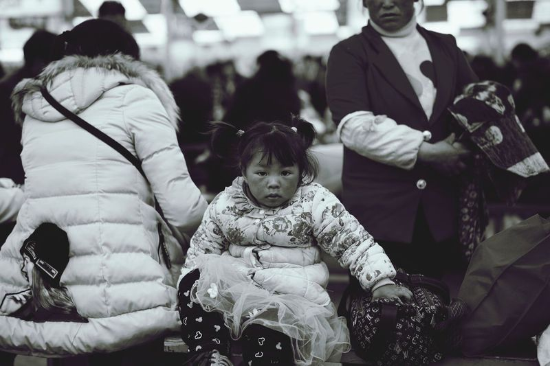 In Chengdu railway station Lifestyles Childhood Real People EyeEm Streetphotography Blackandwhite Black And White Chengdu Leicacamera Capture The Moment Looking At Camera