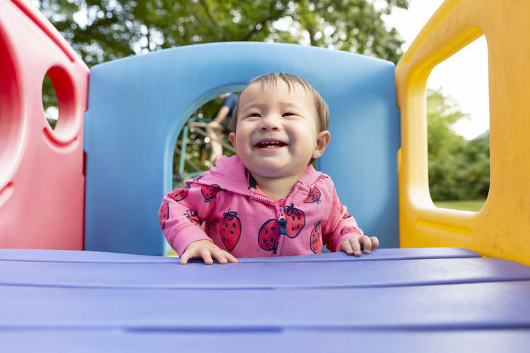 Portrait of cute girl playing at playground