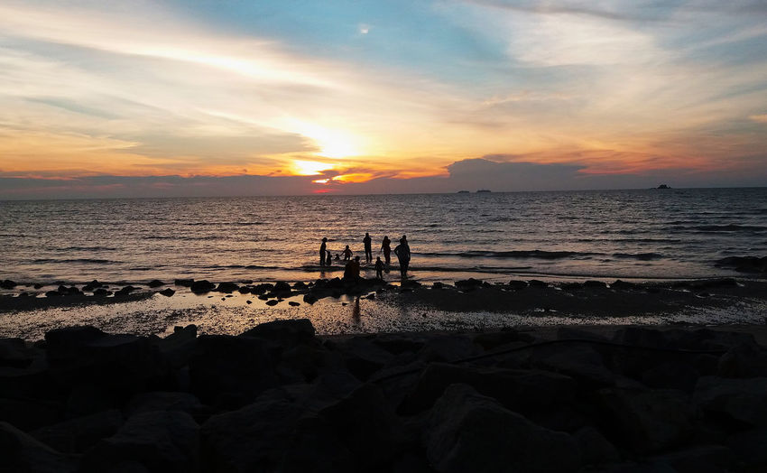 Happy together Beautiful Nature Kuala Selangor Malaysia Peaceful View Relaxing Remis Beach Beach Beauty In Nature Blue Sky Horizon Over Water Nature Outdoors People Sand Scenics Sea Shore Sky Sunset Tranquil Scene Tranquility Water Wave Waves Sound Going Remote