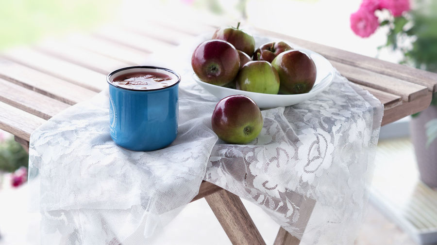 Compote EyeEm Nature Lover EyeEm Gallery Light Apple - Fruit Apples Blue Cup Day Drink Food Food And Drink Freshness Fruit Healthy Eating High Angle View Outdoor Photography Plate Still Life Table White Color Wood - Material Wooden
