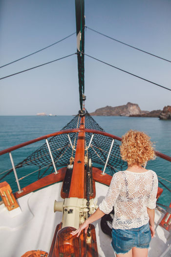 Blonde Blue Boat Curly Hair Girl Greece Holiday Island The Following The Journey Is The Destination On The Way The Great Outdoors - 2016 EyeEm Awards The Portraitist - 2016 EyeEm Awards Nature Outdoors Sailing Santorini Scenics The Essence Of Summer Tranquil Scene Original Experiences Feel The Journey Vacation Vacations Water Breathing Space Done That. An Eye For Travel It's About The Journey