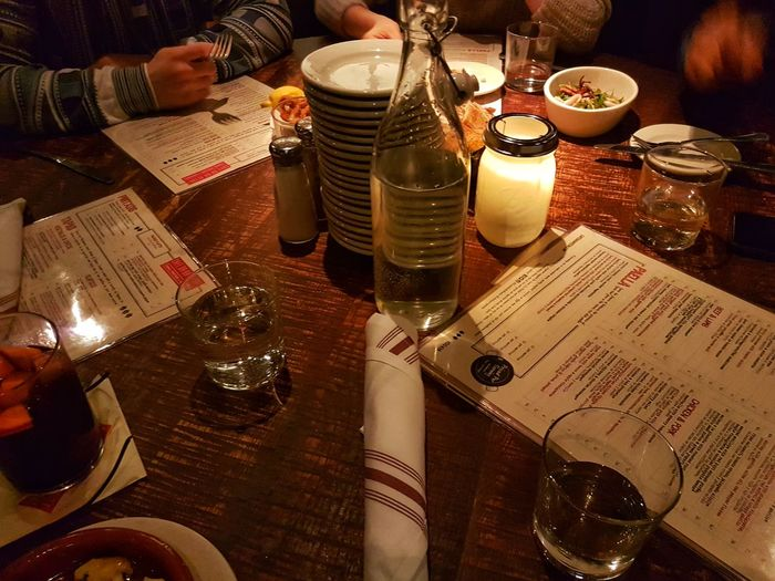 High angle view of wine glasses on table at restaurant