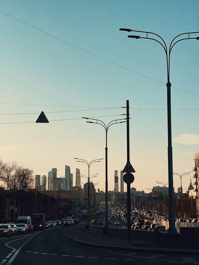 Street lights against sky during sunset