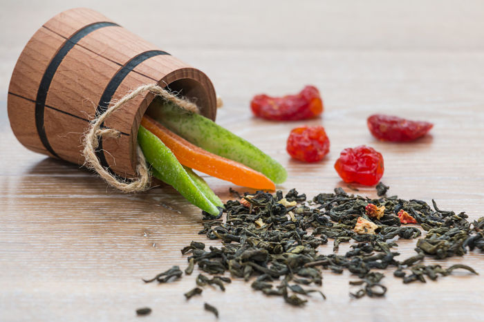 green tea and dried fruits on a wooden surface Beverage Breakfast Detox Rustic Slim Tea Thirst Antioxidant Background Berry Blurred Background Blurry Dehydration Drink Dry Drying Fruits Fruit Green Tea Leaf Morning Rituals Rejuvenation Slimming Vegan Vitamin Wooden Matcha Tea Tea Ceremony Vitamin C Leaves Tea Leaves