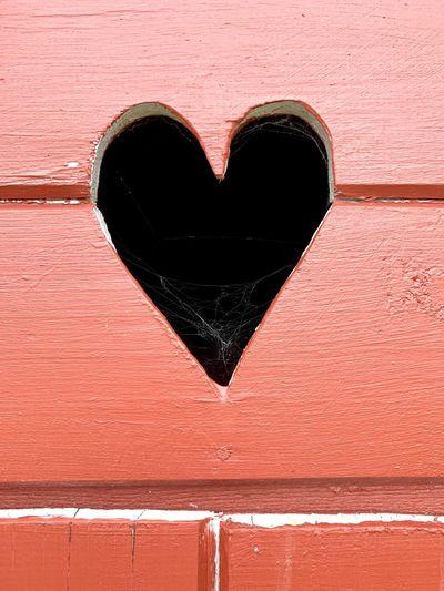 Close-up of heart shape on brick wall
