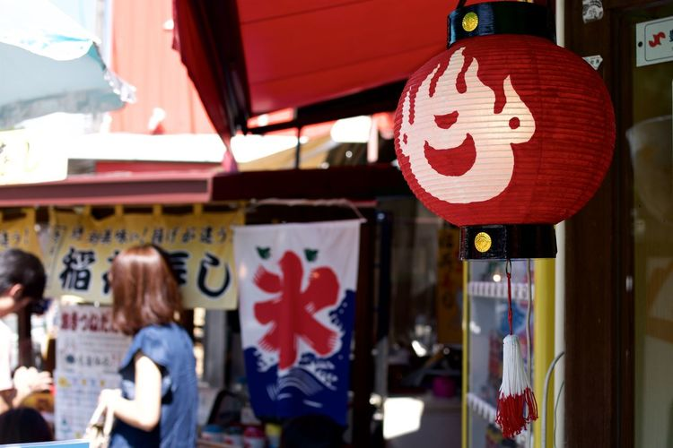 View Of Red Lantern Hanging Outside Door