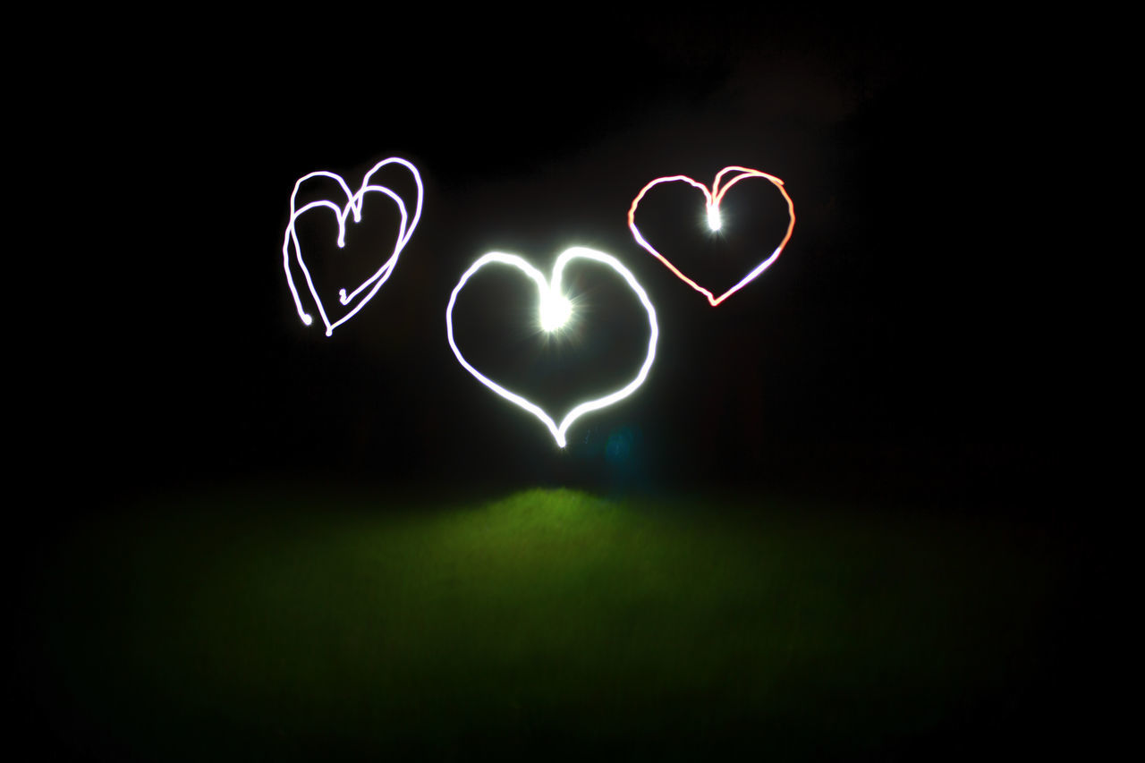 heart shape, night, love, light painting, romance, illuminated, green color, no people, black background, outdoors, nature, close-up, sky