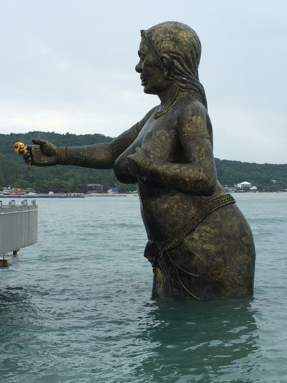 statue, sculpture, art and craft, human representation, water, day, outdoors, waterfront, no people, sky, nature, beauty in nature