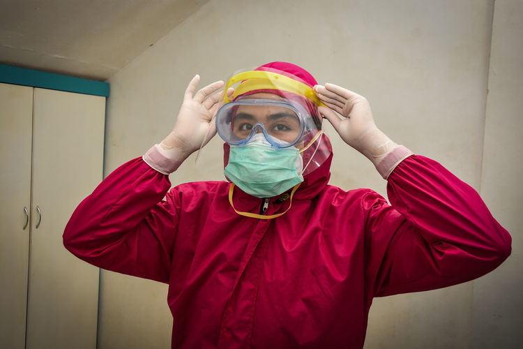 Portrait of doctor wearing mask and protection suits