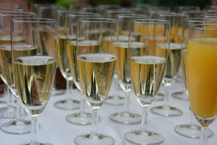 Close-up of alcohol glasses on table at wedding reception
