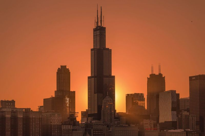 EyeEm Selects Chicago Skyscraper Architecture Building Exterior Sunset Modern Built Structure Cityscape City Tower Urban Skyline Travel Destinations Sky No People Outdoors Office Park Day