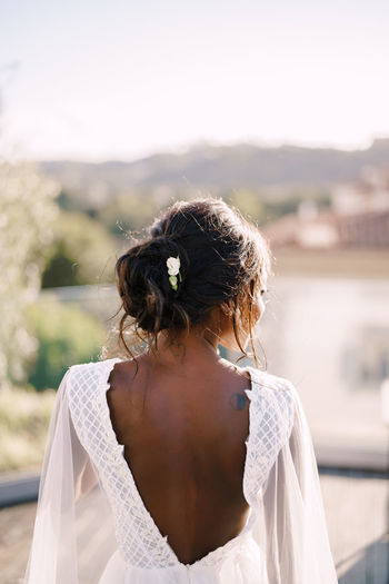 Rear view of bride looking at view outdoors