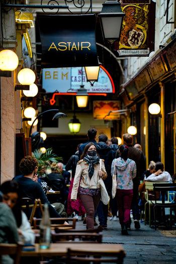 People walking on street in restaurant