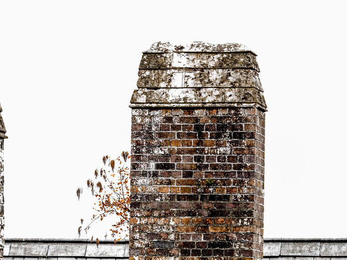 chimney Abandoned Architecture Bad Condition Building Building Exterior Built Structure Clear Sky Copy Space Day Deterioration Metal Nature No People Old Outdoors Rusty Sky Wall - Building Feature Weathered White Background Wood - Material