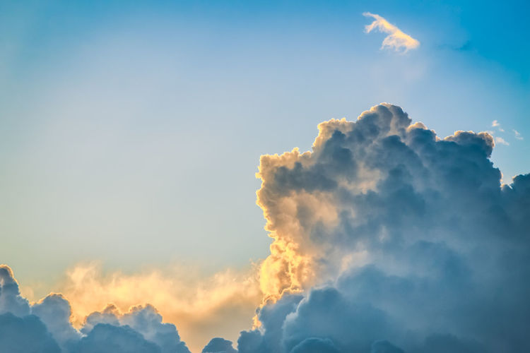 Low angle view of clouds in sky at sunset