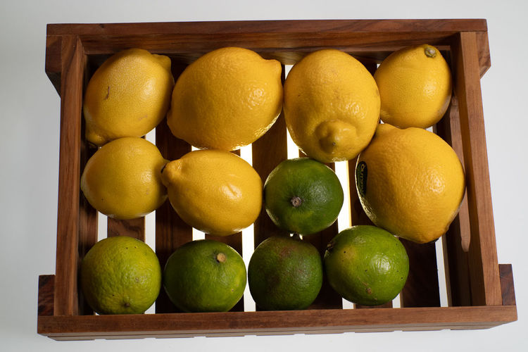Lemons Food And Drink Fruits And Vegetables Choice Citrus Fruit Container Day Directly Above Food Food And Drink Freshness Fruit Green Color Healthy Eating Illuminated Indoors  Large Group Of Objects Lemon Lemons Light Table Lime No People Still Life Studio Shot Wellbeing Yellow