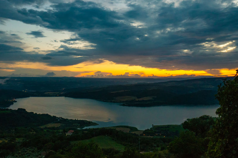 EyeEm Nature Lover EyeEm Selects EyeEmNewHere Hills Lowlight Tranquility Trees Backgrounds Clouds Europe Italy Lago Di Corbara Lake Landscape No People Non Urban Scene Orange Color Sunset Tourism Travel Destinations Umbria Water