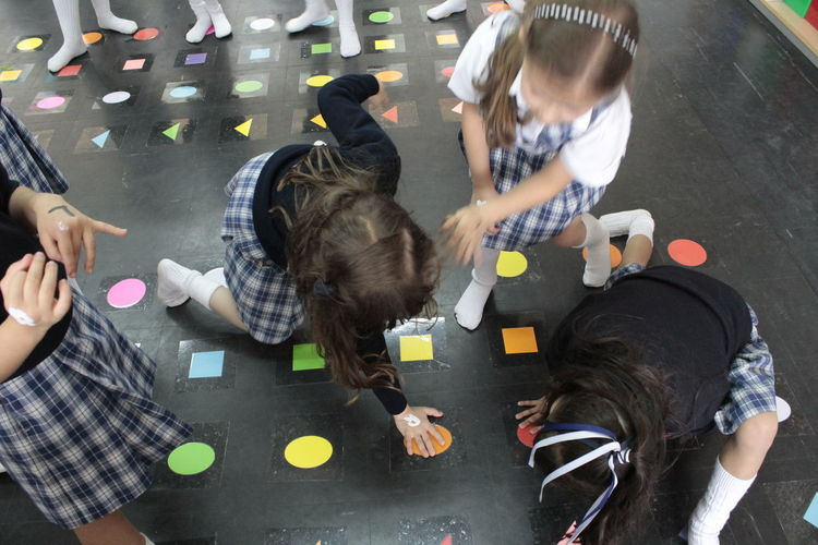 Schoolgirls Playing Together In School