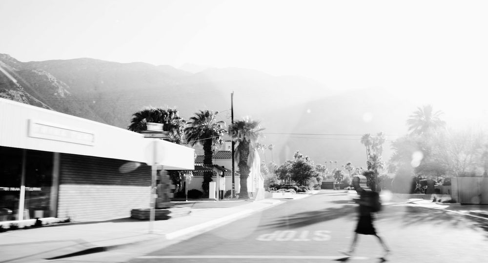 Black And White Building Exterior Built Structure Clear Sky Copy Space Crossing The Street Hazy  Landscapes With WhiteWall Mountain My Commute Overexposed Palm Springs Road Sky Street Walking