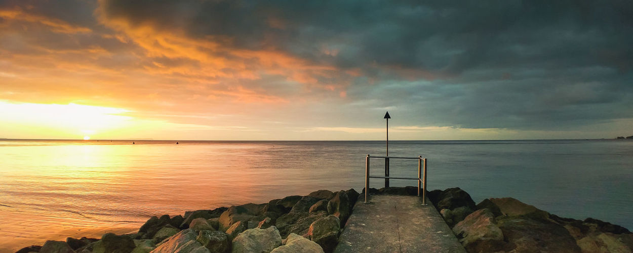 Sandbanks, UK Water Sky Sea Scenics - Nature Sunset Beauty In Nature Cloud - Sky Tranquil Scene Tranquility Horizon Horizon Over Water Nature Rock Idyllic Rock - Object Orange Color Beach Solid Non-urban Scene No People Outdoors Sun Wooden Post Anamorphic Sandbanks Poole