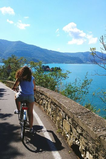 Enjoy The New Normal Cloud - Sky Sky One Person Outdoors Scenics Sea Nature Beauty In Nature Adult Beach Cycling Real People People Day Adults Only Mountain Tree One Man Only Lake Sister Bike