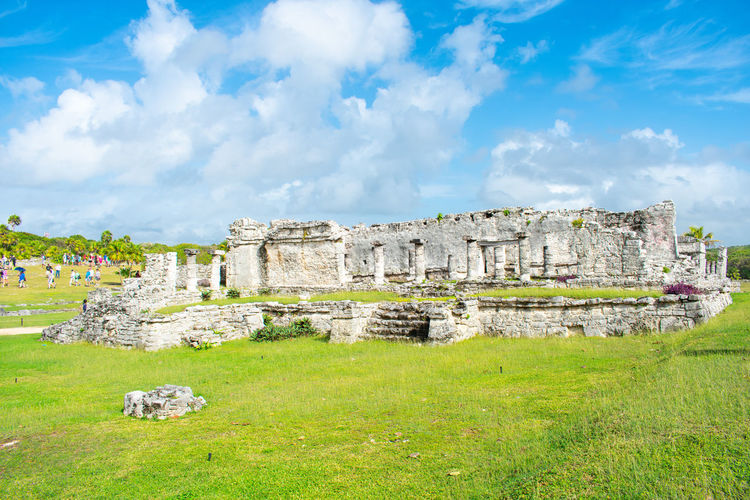 Tulum Mexico Ruins Unesco Zona Arqueológica Architecture Built Structure Ancient History The Past Sky Cloud - Sky Old Ruin Nature Grass Plant Day Old Building Exterior Travel Destinations Travel Land Field Ancient Civilization Archaeology No People Ruined Outdoors