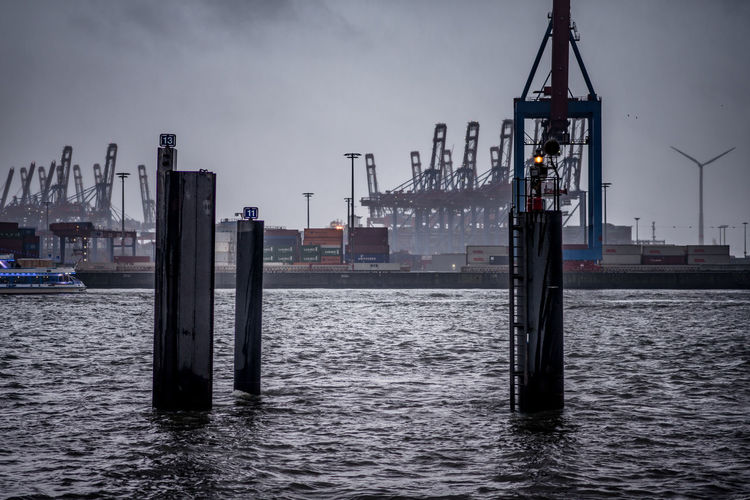 Container ship moored at harbor in city