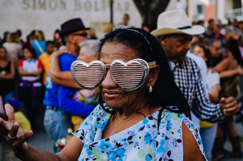 Caracas Carnival The Art Of Street Photography Focus On Foreground Real People Women Glasses Group Of People Incidental People Leisure Activity Lifestyles Adult Sunglasses People Enjoyment Young Adult Celebration Men Event Headshot Happiness Day Portrait Outdoors EyeEm Best Shots EyeEm Selects Streetphotography Street Photography The Street Photographer - 2019 EyeEm Awards