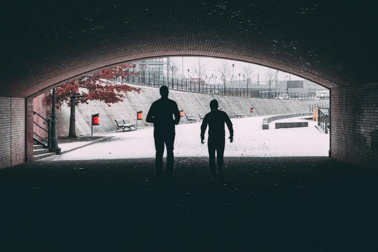 Silhouette of people walking in snow