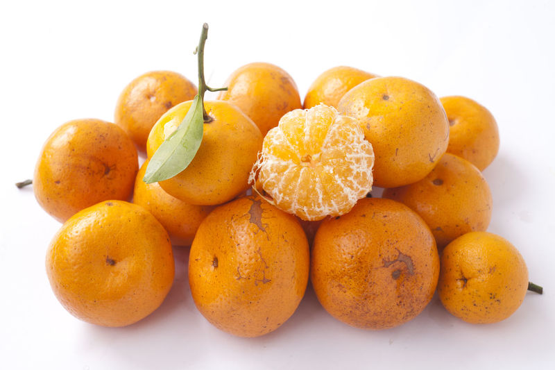 Close Up of Orange Fruit Close-up Food Food And Drink Freshness Fruit Group Of Objects Healthy Eating No People Orange Orange Color Orange Fruit Ready-to-eat Studio Shot Tropical Fruit Vitamin C White Background