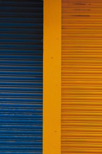 Two sides Pattern Full Frame Yellow Backgrounds No People Metal Wall - Building Feature Textured  Blue Iron Corrugated Iron Architecture