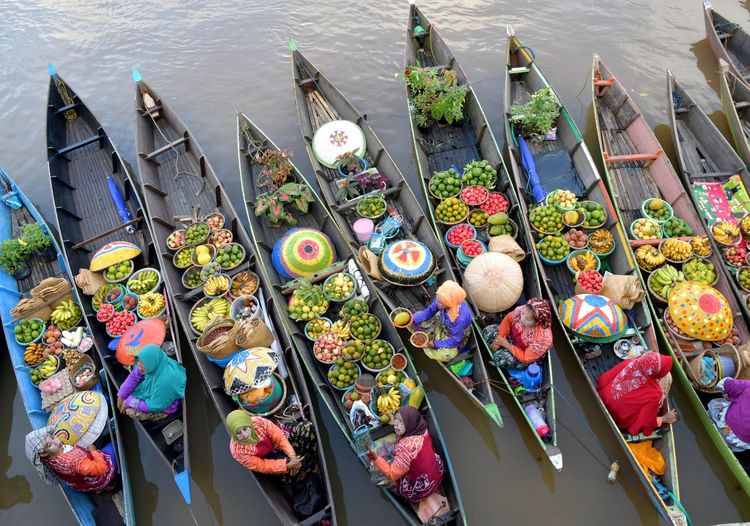High angle view of vendors selling fruits on boats in river