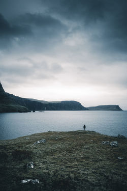 Feel the elements. Location: Isle Of Skye, Scotland. Equipment: Fujifilm X-T2 + XF18-55. Edge EyeEm Best Shots EyeEm Nature Lover One Person Only Beauty In Nature Cloud - Sky Day Isle Of Skye Lake Lifestyles Looking At View Mountain Nature Neist Point Non-urban Scene One Man Only One Person Outdoors Real People Scenics - Nature Sky Standing Tranquil Scene Tranquility Water The Great Outdoors - 2018 EyeEm Awards The Traveler - 2018 EyeEm Awards A New Beginning
