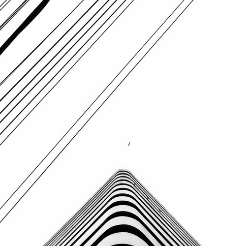 Urbane Welcome To Black EyeEmNewHere Bnw Minimalistic Built Structure Low Angle View Architecture Clear Sky Building Exterior Outdoors Sky Day No People Connection Electricity Pylon Cable Textured  Minimalism