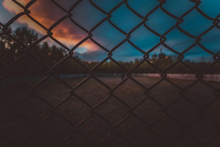 Full frame shot of chainlink fence during dusk