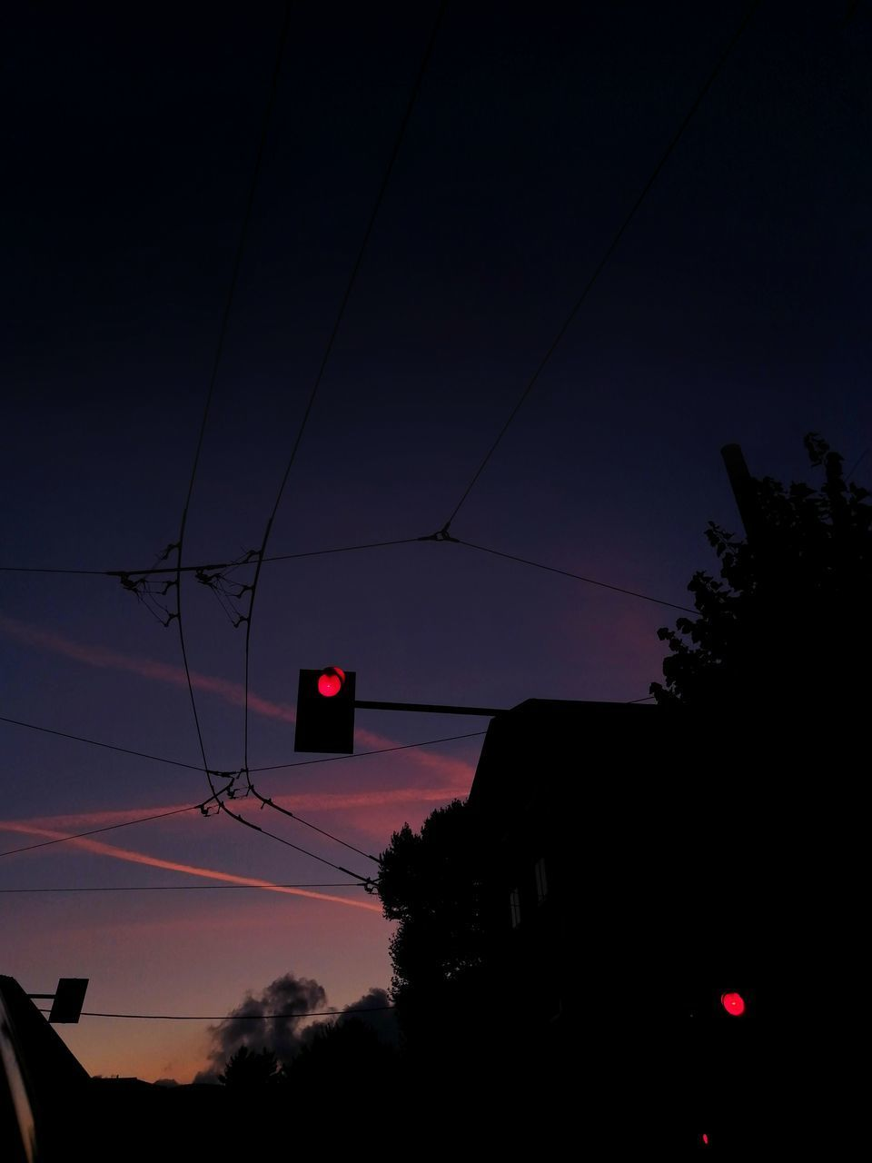LOW ANGLE VIEW OF SILHOUETTE TELEPHONE POLE AGAINST SKY AT SUNSET