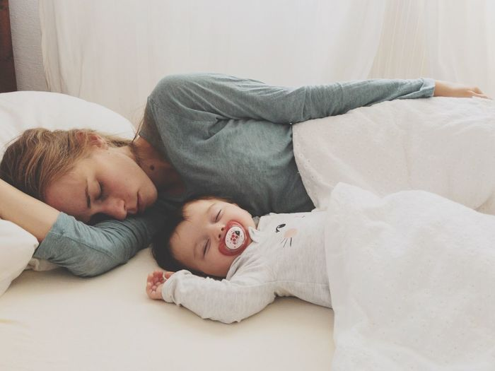 mother and baby still asleep in the morning in bed Cuddling Pacifier Morning EyeEm Selects Lying Down Furniture Indoors  Relaxation Real People Togetherness Sleeping Childhood Lifestyles Child Home Interior Two People Bed Eyes Closed  Love Domestic Room Positive Emotion