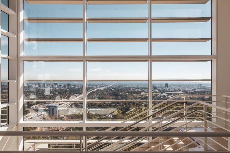 Buildings seen through glass window