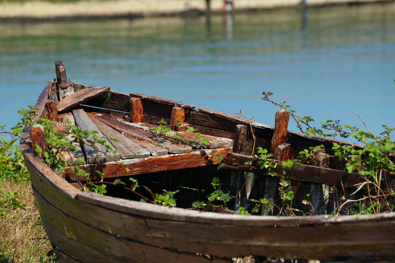 Abandoned Alone Boat Day Grass Hostage Lonely Lonelyness Nature Nautical Vessel No People Outdoors Retired Retirement Rusty Sea Sea View Summer Water Wooden