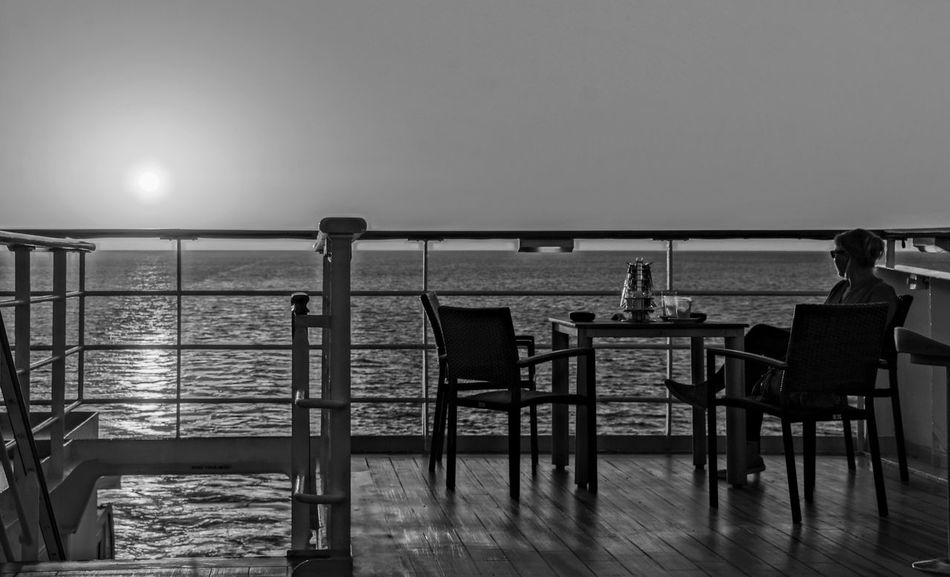 Absence Beauty In Nature Chair Clear Sky Cruise Cruise Ship Dusk Empty Horizon Over Water Kreuzfahrt Kreuzfahrtschiff Nature Non-urban Scene Ocean Outdoors Railing Scenics Sea Seascape Sky Tourism Tranquil Scene Tranquility Vacations Water Sommergefühle Wine Not Breathing Space Investing In Quality Of Life Black And White Friday An Eye For Travel