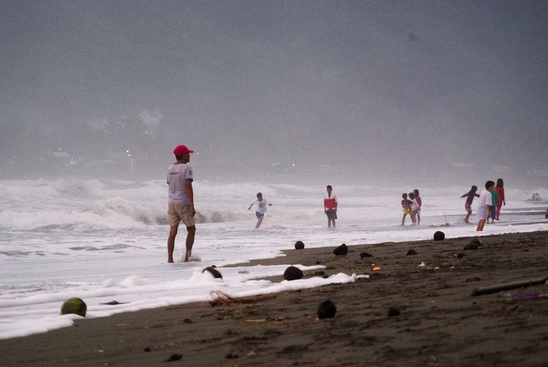 busy shoreline Smoke Children Playing Children Playing On Beach Mist Misty Morning Sand Sea Sea And Sky Shore EyeEmNewHere The Street Photographer - 2018 EyeEm Awards
