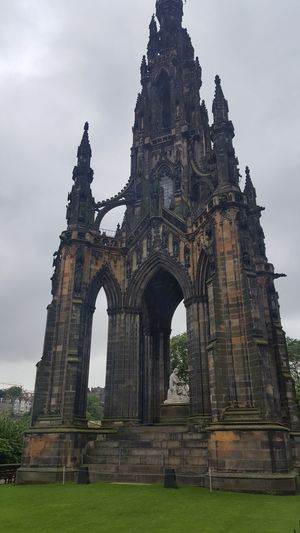"The Scott Monument is a Victorian Gothic monument to Scottish author Sir Walter Scott. It is the largest monument to a writer in the world. It stands in Princes Street Gardens in Edinburgh, opposite the Jenners department store on Princes Street and near to Edinburgh Waverley Railway Station, which is named after Scott's Waverley novels. The tower is 200 feet 6 inches (61.11 m) high, and has a series of viewing platforms reached by a series of narrow spiral staircases giving panoramic views of central Edinburgh and its surroundings. The highest platform is reached by a total of 287 steps (those who climb the steps can obtain a certificate commemorating their achievement). It is built from Binny sandstone quarried near Ecclesmachan in West Lothian. In terms of its location, it is placed on axis with South St David Street, the main street leading off St Andrew Square to Princes Street, and is a focal point within that vista, its scale being large enough to totally screen the Old Town behind. As seen from the south side, Princes Street Gardens, its location appears more random, but it totally dominates the Eastern Section of the gardens, through a combination of its scale and elevated position relative to the sunken gardens. Following Scott's death in 1832, a competition was held to design a monument to him. An unlikely entrant went under the pseudonym ""John Morvo"", the name of the medieval architect ofMelrose Abbey. Morvo was in fact George Meikle Kemp, forty-five-year-old joiner, draftsman, and self-taught architect. Kemp had feared his lack of architectural qualifications and reputation would disqualify him, but his design (similar to an unsuccessful one he had earlier submitted for Glasgow Cathedral) was popular with the competition's judges, and in 1838 Kemp was awarded the contract to construct the monument. John Steell was commissioned to design a monumental statue of Scott to rest in the space between the tower's four columns. Steell's statue, made from white Carrara marble, shows Scott seated, resting from writing one of his works with a quill pen and his dog Maida by his side. The monument carries 64 figures (carried out in three phases) of characters from Scott's novels by a variety of Scots sculptors including, Alexander Handyside Ritchie, John Rhind, William Birnie Rhind, William Brodie, William Grant Stevenson, David Watson Stevenson, John Hutchison,George Anderson Lawson, Thomas Stuart Burnett, William Shirreffs, Andrew Currie, George Clark Stanton, Peter Slater, and two female representatives, Amelia Robertson Hill (who also made the statue of David Livingstone immediately east of the monument), who contributed three figures to the monument, and the otherwise unknown Katherine Anne Fraser Tytler. The foundation stone was laid on 15 August 1840. Following permission by an Act of Parliament (the Monument to Sir Walter Scott Act 1841 (4 & 5 Vict.) C A P. XV.), construction began in 1841 and ran for nearly four years. The tower was completed in the autumn of 1844, with Kemp's son placing the finial in August of the year. The total cost was just over £16,154. When the monument was inaugurated on 15 August 1846, George Meikle Kemp himself was absent; Kemp having fallen into the Union Canal while walking home from the site on the foggy evening of 6 March 1844 and drowned. In total (excluding Scott and his dog) there are 68 figurative statues on the monument of which 64 are visible from the ground. Four figures are placed above the final viewing gallery and are only visible by telephoto or (at a very distorted angle) from the viewing gallery itself. In addition, eight kneeling Druid figures support the final viewing gallery. There are 32 unfilled niches at higher level. Sixteen heads of Scottish poets and writers appear on the lower faces, at the top of the lower pilasters. The heads (anti-clockwise from the NW) represent: James Hogg; Robert Burns; Robert Fergusson; Allan Ramsay; George Buchanan; Sir David Lindsay; Robert Tannahill; Lord Byron; Tobias Smollett; James Beattie; James Thomson; John Home; Mary, Queen of Scots; King James I of Scotland; King James V of Scotland; and William Drummond of Hawthornden. In total, 93 persons are depicted, plus two dogs and a pig. In the early 1990s it was proposed that the stonework should be cleaned. There were views for and against cleaning and a scientific/geological investigation, including cleaning trials on samples of stone, was carried out. It was decided not to clean the stone due to the damage it would sustain. A restoration programme was undertaken involving replacing old repairs and damaged areas with Binny stone for which purpose the original quarry was re-opened. The fresh stonework contrasts with the smoke-darkened original. The overall cost of the restoration was £2.36 million and was funded by the Heritage Lottery Fund, Historic Scotland and the City of Edinburgh Council. The monument is now administered by the Culture and Sport division of the City of Edinburgh Council. The monument is featured prominently in the movie Cloud Atlas, as a location which the character Robert Frobisher frequents. Architecture Architecture & Statues Architecture Details Architecture Facade Architecture Photography Architecture_bw Architecture_collection Architecturelovers Architectureporn EyeEm Best Shots From My Point Of View Gothic Gothic Architecture Hidden Gems  Historical Monuments Portrait Princes Street Princes Street Gardens Scotland Scott Scott Monument Scottish Victorian Victorian Architecture Walter Scott"