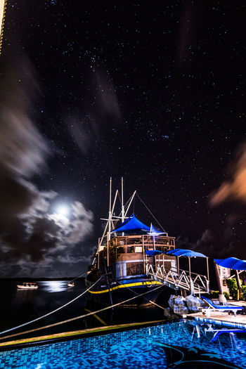 Night landscape. A moored ship in the moonlight night at a tropical lagoon. Yap island, Federated States of Micronesia Nightphotography Ship Moored Lagoon Star - Space Moon Moonlight Moon Light Reflections In The Water Bay Area Sky And Clouds Copy Space Yap Island Micronesia Resortlife Vacation Destination Calm Water Pacific Ocean Tropical Paradise Tropical Stars Black Background Shipyard Blue Silence Moment