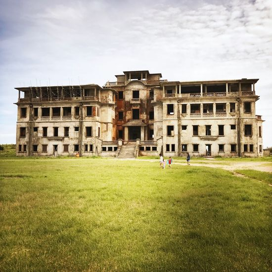 Building Ruins Bokor Mountain Architecture Built Structure Grass Building Exterior History Sky Real People Travel Destinations Day Green Color Outdoors Ancient Large Group Of People Nature Tree Ancient Civilization People