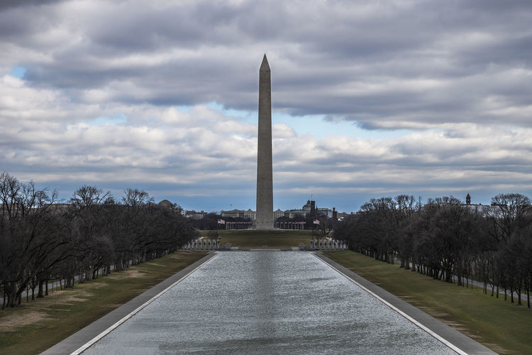 View of washington monument against cloudy sky