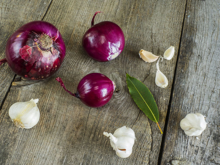 raw red onion and garlick on old weathered wooden background Background Close-up Food Food And Drink Freshness Garlick Healthy Eating High Angle View Indoors  No People Old Onion Raw Red Table Weathered Wooden